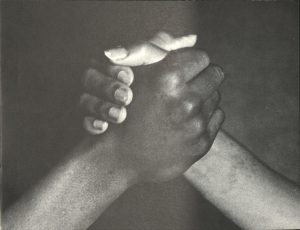 two people holding hands
